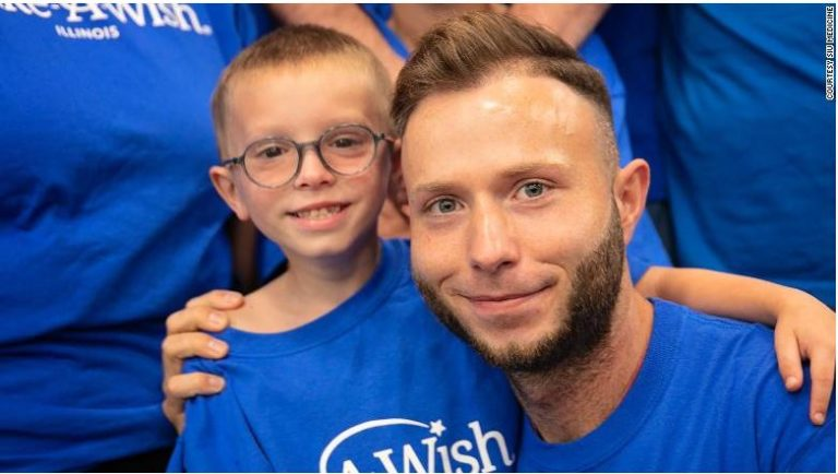 Bone marrow transplant recipient Gabriel Smith, left, meets his bone marrow donor Dennis Gutt at the Southern Illinois University School of Medicine in Springfield, Illinois, as part of Gabriel's Make-A-Wish request.
