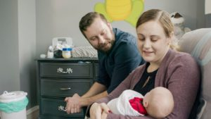 n this undated photograph provided by Penn Medicine, Jennifer and Drew Gobrecht look at their baby, Benjamin, at home in Ridley Park, Pa. Jennifer gave birth in November 2019 following a uterine transplant. (Penn Medicine via AP)