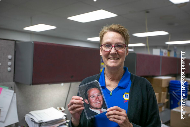 Debie Switalski is alive because of the liver transplant she received. She carries a picture of Zachary, the man whose choice to be a donor saved her life.